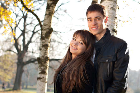 Young beautiful happy smiling couple in love against the background of beauti sunny nature Reklamní fotografie