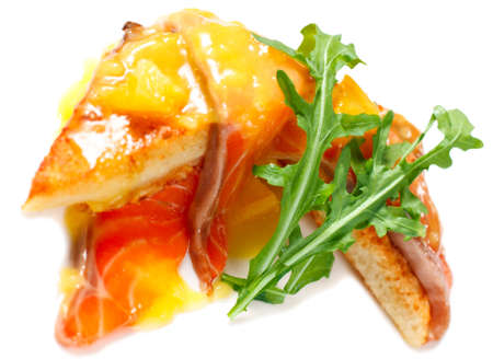 French breakfast the toast with an egg, salmon and orange sauce. Isolated on white Stock Photo - 12249737