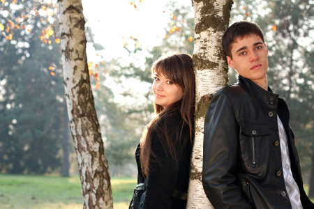 Young beautiful couple in love among the birch trees in outdoors