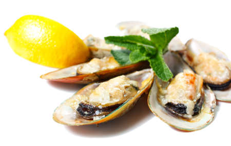 Mussels in the shell baked with parmesan cheese, lemon and basil photo