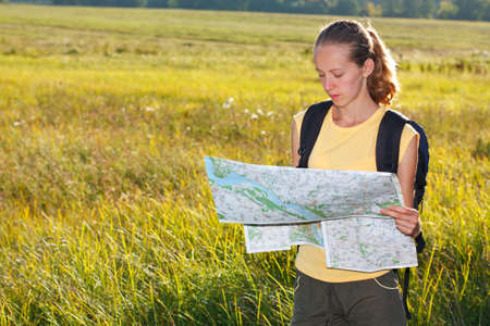 Woman traveler read the map among the green summer nature Stock Photo - 12580594