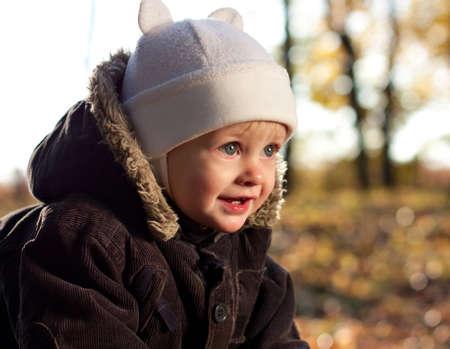 Portrait cute joyful child against a background of golden nature  Blurred background photo