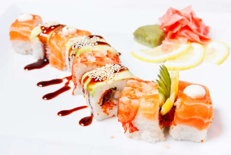 Sushi Roll with salmon, eel, tiger shrimp, tobiko caviar,  avocado and cucumber   Orange Dragon  photo
