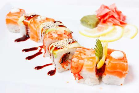 Sushi Roll with salmon, eel, tiger shrimp, tobiko caviar,  avocado and cucumber   Orange Dragon  Stock Photo