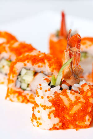 Sushi Roll with tobiko caviar, tiger prawn, avocado and cucumber close-up Stock Photo - 12806365