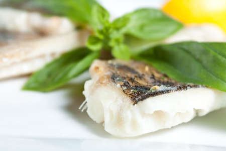 healt: Pike Perch Fillet with Basil closeup  Tasty and nutritious freshwater fish