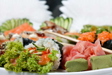 Sushi Assorted with Roll, Hand Roll, Sashimi, Ginger and Wasabi close-up Stock Photo - 12806372