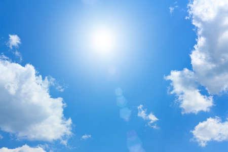Blue Sky with Beautiful Cumulus Clouds and Sun