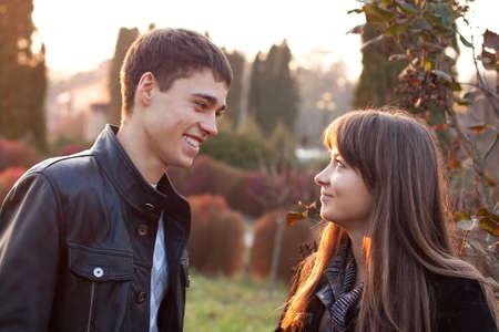 Happy smiling couple against the background of autumn park Reklamní fotografie
