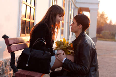 declaration: Young man declaration of love for young woman  Couple in love in sunny evening autumn outdoors Stock Photo