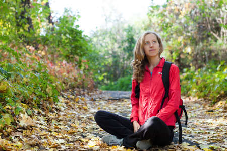 ecotourism: Happy young backpacker enjoying relaxation in the autumn nature  Hiking at vacation