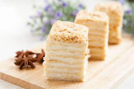 napoleon dessert: Cake Napoleon of puff pastry with sour cream on a plate  Tasty and nutritious dessert Stock Photo