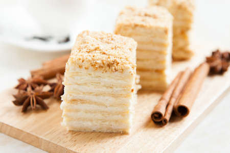 napoleon dessert: Cake Napoleon of puff pastry with sour cream on a plate close-up  Nutritious dessert