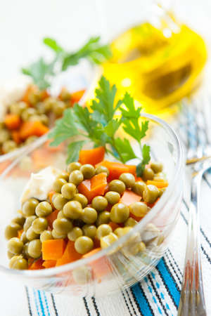 Salad vegetarian with canned green peas, boiled carrots and vegetables  Healthy food Stock Photo - 16665388