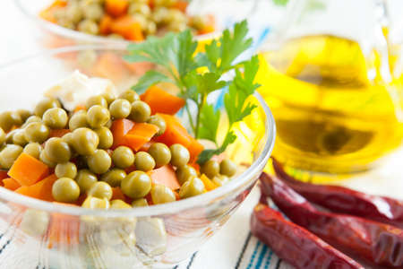 Salad with canned green peas and boiled carrots close up  Healthy and vegetarian food Stock Photo - 16665389