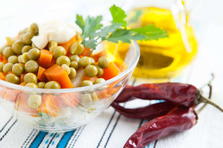 Salad with boiled carrots, canned peas and bottle vegetable oil close up  Vegetarian and  healthy food Stock Photo - 16665364