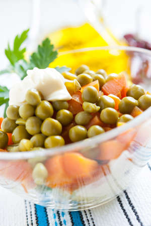 Salad with boiled carrots and canned green peas close up  Vegetarian and  healthy food Stock Photo - 16665362
