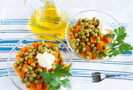 Vegetarian salad with canned peas, boiled carrots and bottle oil on handmade fabric  Top view Stock Photo - 16665402