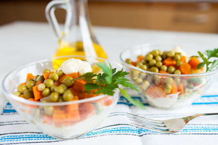 Vegetarian salad with canned peas, boiled carrots, vegetables, mayo and bottle vegetable oil  Healthy food Stock Photo - 16665395