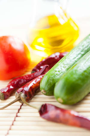 Red hot peppers, cucumber, tomato and bottle vegetable oil  Food ingredients Stock Photo - 16665344