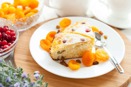 Curd pudding with dried apricot and raisins close-up on a plate  Tasty dessert photo