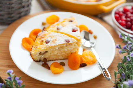 Cheese Pie closeup with dried apricot and raisins  Tasty dessert on a plate Reklamní fotografie
