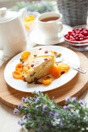 Cheese pudding with tea, dried apricot and raisins closeup  Tasty dessert decorated photo