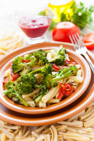 Pasta with broccoli and bulgarian pepper. Tasty italian food Stock Photo - 17560592
