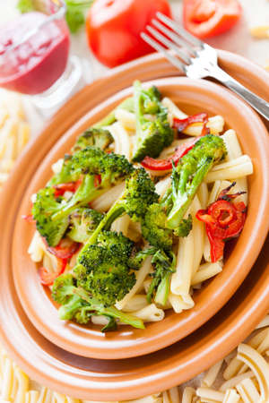 Nutritious pasta with roasted vegetables closeup. Tasty italian food Stock Photo - 17560594