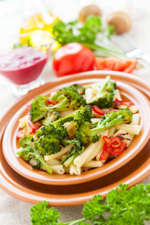 Tasty pasta with broссoli and bulgarian pepper. Italian food Stock Photo - 17575033