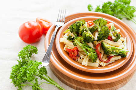 Nutritious Pasta with roasted vegetables broccoli and pepper. Italian food photo