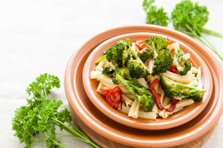 Delicious pasta with pepper and broccoli on a plate closeup. Selective focus Stock Photo - 17560593