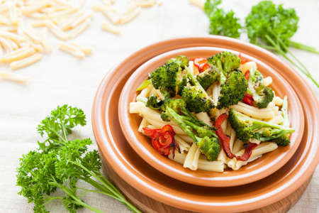 Nutritious pasta with pepper and broccoli on a plate closeup. Selective focus Stock Photo - 17560590