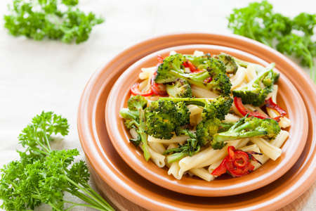 Pasta with pepper and broccoli closeup. Selective focus. Italian food Stock Photo - 17560595