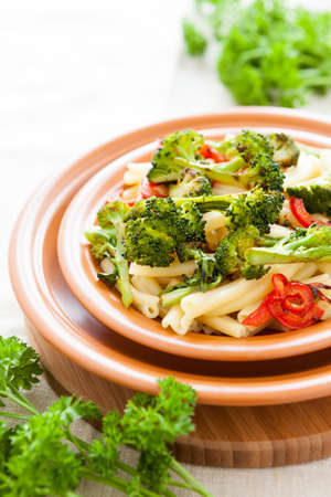 Pasta with broccoli and bulgarian pepper. Delicious italian food Stock Photo - 17575039