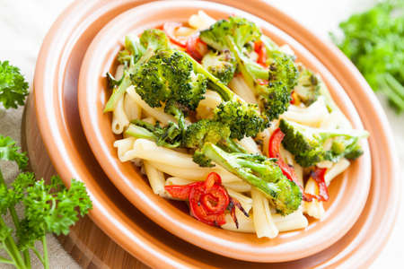 Delicious pasta with pepper and broccoli. Italian food. Selective focus Stock Photo - 17560591
