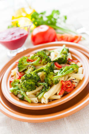 Pasta with vegetables. Italian delicious food. Selective focus photo