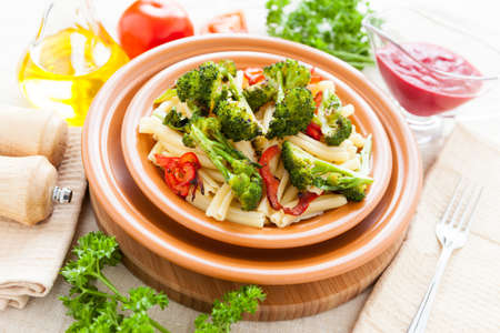 Delicious Pasta with roasted vegetables broccoli and pepper. Italian food photo