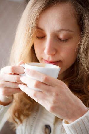 coffeebreak: Beautiful young woman drinking coffee  Cup of hot beverage  Coffee-break Stock Photo