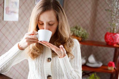 coffeetime: Beautiful gir drinking coffee. Cup of hot aromatic beverage. Coffee-break