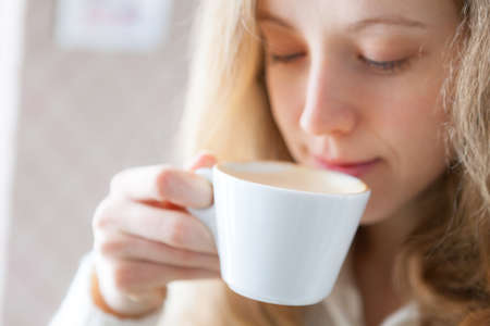 coffeetime: Coffee  Beautiful young woman drinking hot beverage  Coffee-time Stock Photo