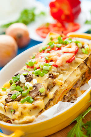 Traditional Italian Lasagna in yellow dish  Delicious mediterranean food photo