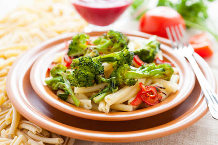 Nutritious pasta with roasted vegetarian vegetables  Tasty italian food photo