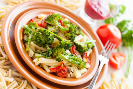 Nutritious Pasta with roasted vegetables  Selective focus  Delicious italian food photo
