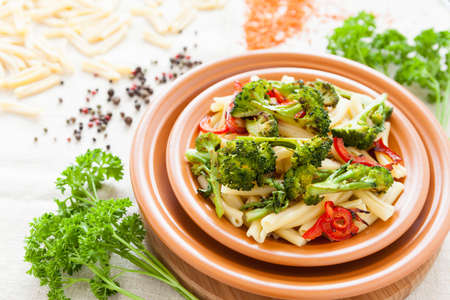 Pasta with roasted vegetables on a plate closeup  Delicious italian food photo