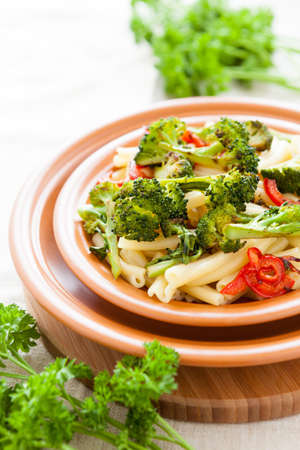 Pasta with pepper and broccoli close up  Selective focus photo
