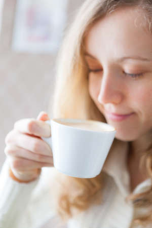 coffeetime: Coffee. Beautiful smiling girl holding in hand a cup of coffee. Coffee-time