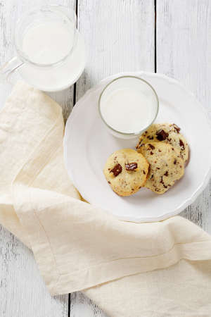 Cookies with milk on the white boards, sweet dessert. Top view photo
