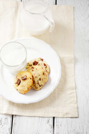 Cookies with chocolate filling and fresh milk, dessert photo