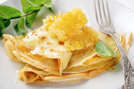 Pancakes with honey for breakfast. Close-up photo